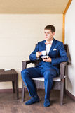 Young Business Man Drinking a Cup of Coffee or Tea Stock Photos