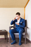 Young Business Man Drinking a Cup of Coffee or Tea Royalty Free Stock Image