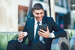 Young business man drinking morning coffee Royalty Free Stock Photography