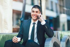 Young business man drinking morning coffee Stock Photography