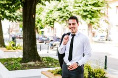Young business Man drinks coffee to go. While standing outdoor Stock Photography