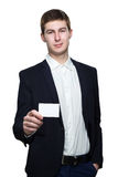 Young business man with empty business card on white background Stock Photo