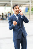 Young business man excite and enjoy of business success on cooperate with partner. Portrait smart business man with excite enjoy acting action Royalty Free Stock Photography