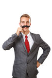 Young business man with fake mustaches. Isolated on white background stock image