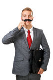 Young business man with fake mustaches Stock Images