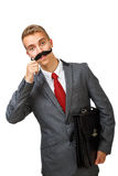 Young business man with fake mustaches Royalty Free Stock Image
