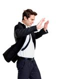Young business man fighting against wind on white Stock Image