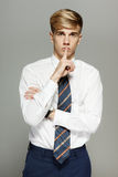Young business man with finger on lips Stock Images