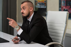Young Business Man With A Finger Point Royalty Free Stock Photography