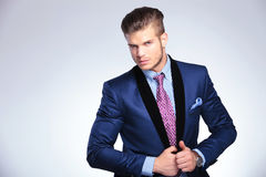 Young business man fixing his jacket Stock Image