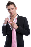 Young Business man, fixing his tie Royalty Free Stock Photos