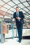 Young business man with formal suit using digital tablet Royalty Free Stock Images