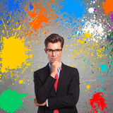 Man with color splashes around him Stock Photo