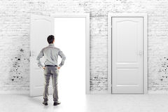 Young business man in front of an open door royalty free stock photos