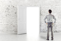 Young business man in front of an open door Royalty Free Stock Photo