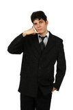Young business man gesturing a call isolated Stock Photo