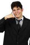 Young business man gesturing a call isolated Stock Photos