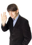 Young business man gesturing okay sign isolated on white backgr Stock Photography