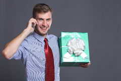 Young business man with gifts Stock Photo
