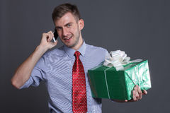 Young business man with gifts Stock Images