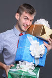 Young business man with gifts Stock Photography