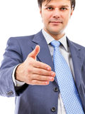 Young business man giving hand for handshake Royalty Free Stock Images