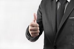 Young business man giving thumb up. Isolated on white Stock Photography