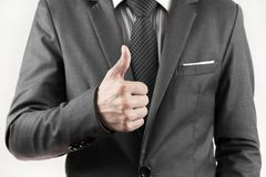 Young business man giving thumb up Stock Image