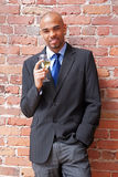 Young business man with a glass of wine stock photography