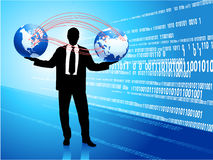 Young business man with globe silhouettes Royalty Free Stock Photography