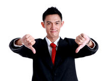 Young business man going thumb down, isolated on white Stock Images