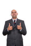 Young business man going thumbs up stock images