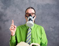 Young business man in green shirt with gas mask Royalty Free Stock Image