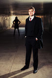 Young fashion business man in underground tunnel Royalty Free Stock Photos