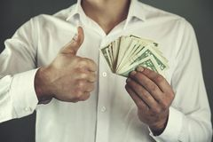 Man hand money and okay sign. Young business man hand money and okay sign royalty free stock image