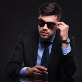 Young business man with hand on sunglasses Royalty Free Stock Images