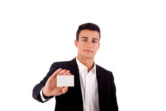 Young business man handing a blank business card over white back Stock Photo