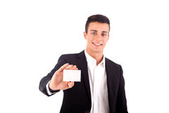 Young business man handing a blank business card over white back Stock Image