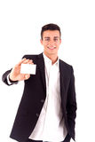 Young business man handing a blank business card over white back Royalty Free Stock Photos