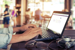 young business man hands busy working on his laptop sitting at wooden table Royalty Free Stock Images