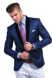 Young business man with hands on jacket Royalty Free Stock Photo