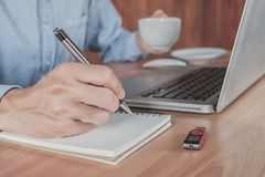 Young business man hands with pen writing Stock Photo