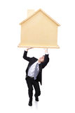 Young business man have heavy home loan Royalty Free Stock Images