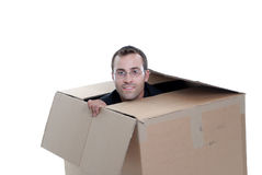 Young business man hiding in a cardboard box Royalty Free Stock Image
