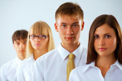 Young business man with his colleagues Royalty Free Stock Photos