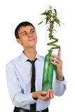Young business man hold flower Royalty Free Stock Images