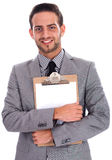 Young Business Man Holding A Clip Board Stock Photography