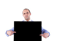 Young business man holding a blackboard Stock Photo