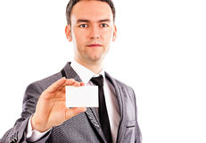 Young business man holding a blank business card Royalty Free Stock Photos