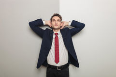 Young business man holding both hand to his head Royalty Free Stock Image